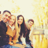group of friends taking selfie in autumn park