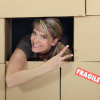 Woman in a wall of cardboard boxes