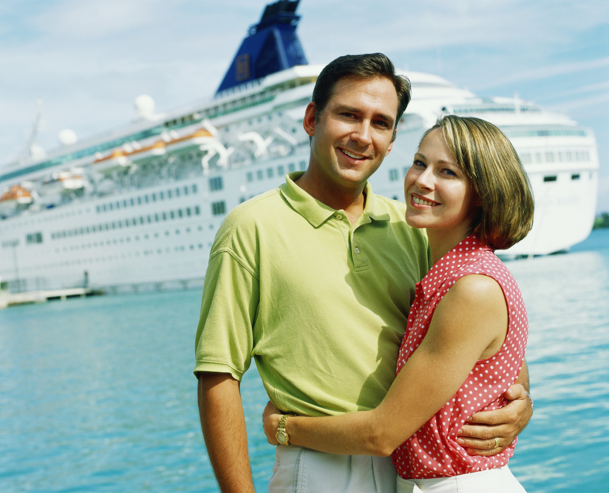 Portrait of couple, cruise ship in background