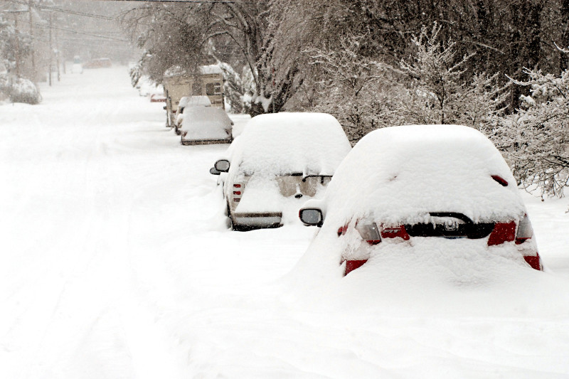 A car and street covered in the snow