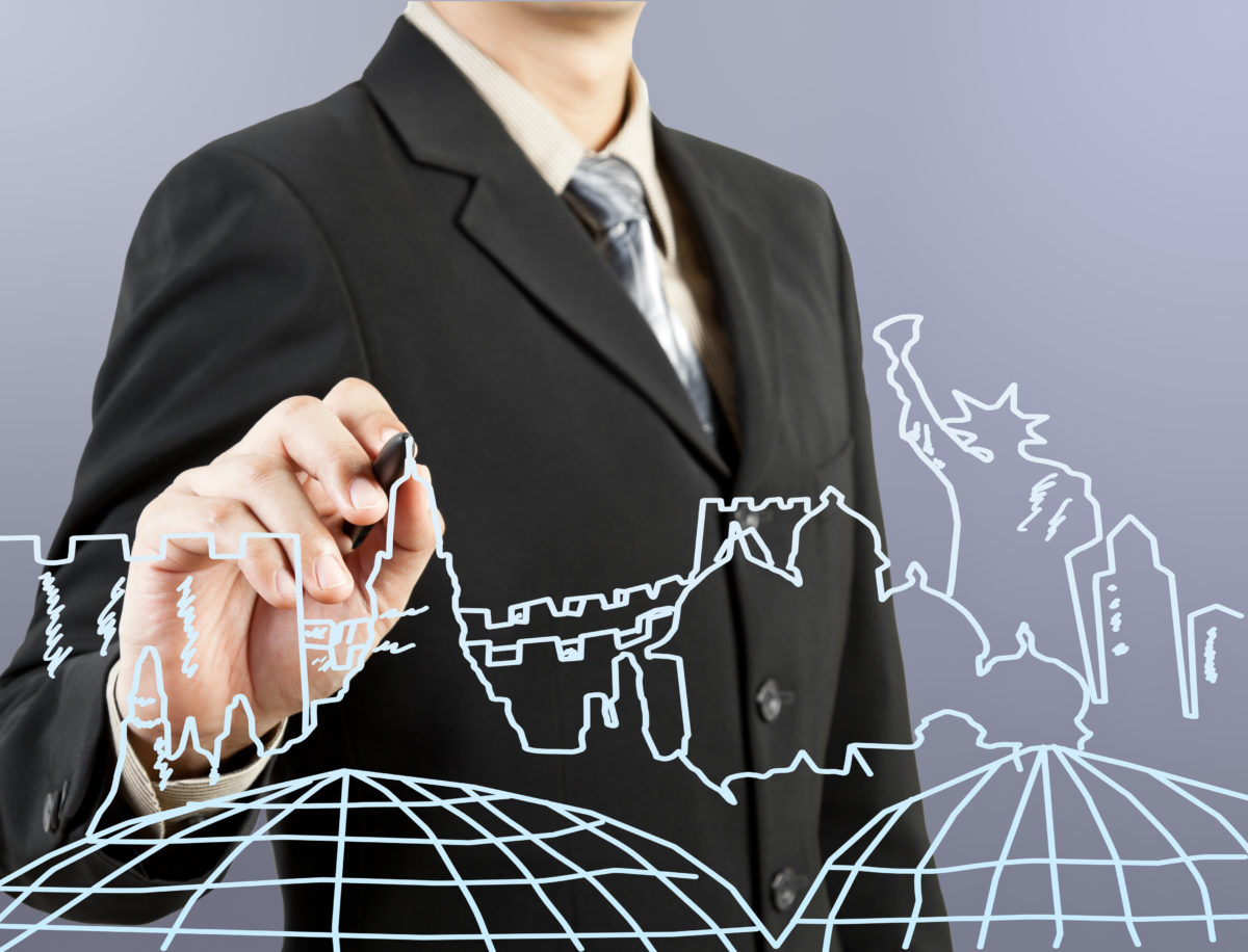 businessman hand drawing the dream travel around the world