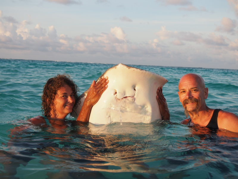 Vacation Quest members in Grand Caymans with sting ray.